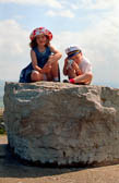 Brother_-_Sister_Sitting_On_A_Rock_-001.jpg